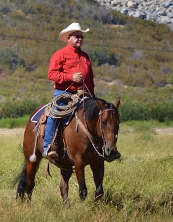 Earl Graham, cattle rancher, on horseback